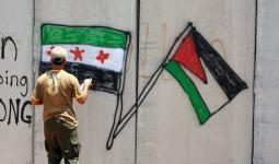 علما فلسطين والثورة السورية في رسمة جدارية