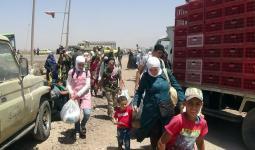 صورة أرشيفية لنزوح عائلات سورية من درعا