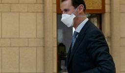 بشار الأسد يضع كمامة