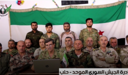 العميد أبو قصي خلال قراءته لبيان الجيش السوري الموحد