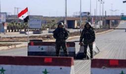 عناصر من ميليشيات الأسد في حاجز