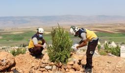 عناصر من الدفاع المدني في مقبرة بمحافظة إدلب 20 7 2021