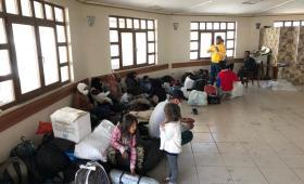 مجموعة من المهاجرين في صالة أوتوغار أسنلر