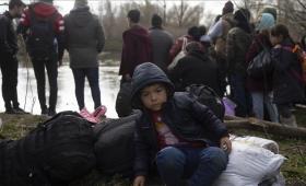 مهاجرين في اليونان خلال تعرضهم للقمع