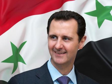 بشار الأسد وعلم النظام في سوريا