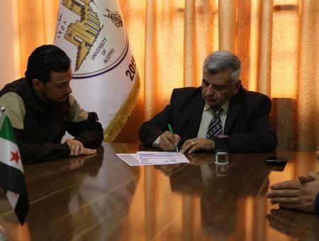 رئيس جامعة حلب الحرة يوقع بروتوكولا مع ممثلي إدارة الدفاع المدني السوري